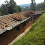 Damage to roof of the Girls' Dormitory of the Frank Adams Compound School of Kibogora